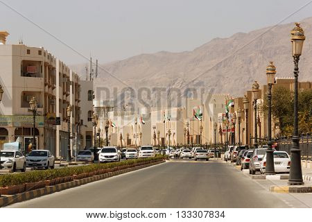 DIBBA AL HISN, UNITED ARAB EMIRATES, 6 APRIL 2016. Editorial Photograph of Governmental buildings with mountain backdrop on Al Akd Al Fareed Street, Dibba Al Hisn, Sharjah, UAE