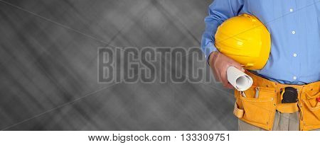 Construction worker with helmet and tool belt.