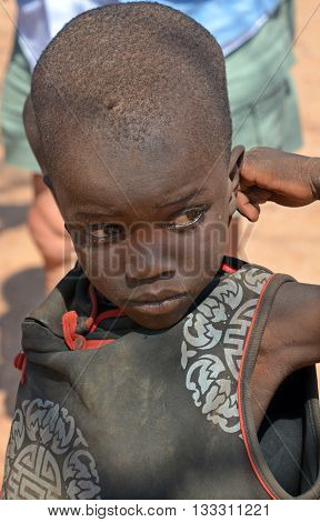 OTJIKANDERO NAMIBIA OCTOBER 09, 2014: Unidentified child Himba tribe. Otjikandero Himba Orphan Village Project has started when Jaco Burger moved to Kaokoland to work and live with Himba tribe.