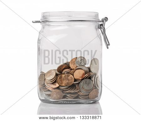 A jar with american change used for savings or tips isolated on white with reflection.