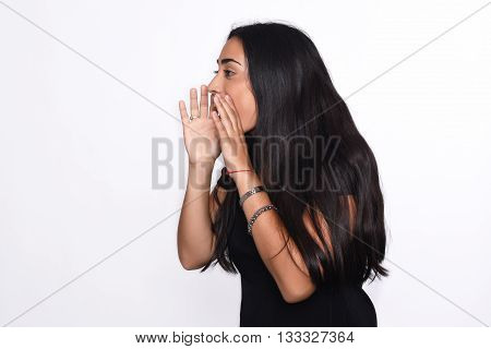 Beautiful young woman shouting and screaming. Isolated white background.