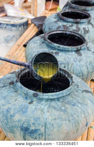 Natural indigo dyeing in earthen jar; folk wisdom of Thailand