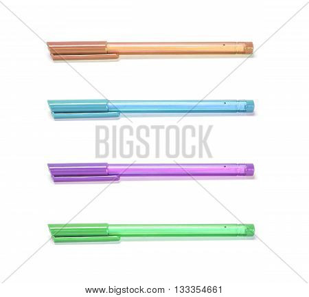 Closeup color pens brown pen blue pen purple pen green pen isolated on white background