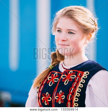 Gomel, Belarus - March 12, 2016: Portrait of unknown beautiful young woman girl in national folk clothes at Celebration of Maslenitsa Shrovetide holiday.