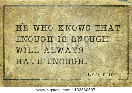 He who knows that enough is enough will - ancient Chinese philosopher Lao Tzu quote printed on grunge vintage cardboard