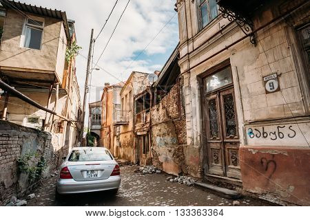 Tbilisi, Georgia - May 19, 2016: Car brand Mercedes-Benz E 320 is parked on a narrow street in the old part of Tbilisi