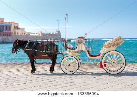 The elegant horse-drawn carriage on the central promenade of Chania.