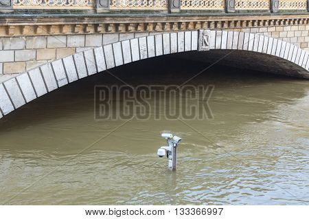Surveillance cameras on the top of a pole are almost covered by water on the River Seine embankment after the massive flooding in Paris during the first days of June 2016.