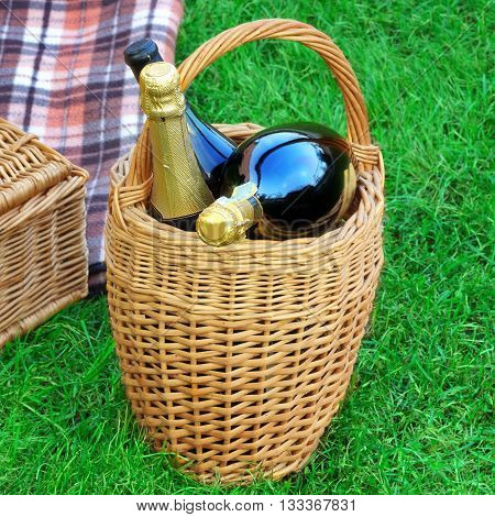 Basket With Champagne Wine, Picnic Hamper And Blanket