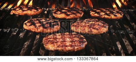 Grilled Burgers Patties On The Hot Flaming Grill