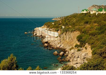 rocky promontory with houses by the sea