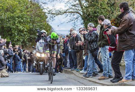 Conflans-Sainte-Honorine,France-March 6,2016: The British cyclist Daniel Mc Lay of Fortuneo-Vital Concept Team riding during the prologue stage of Paris-Nice 2016.