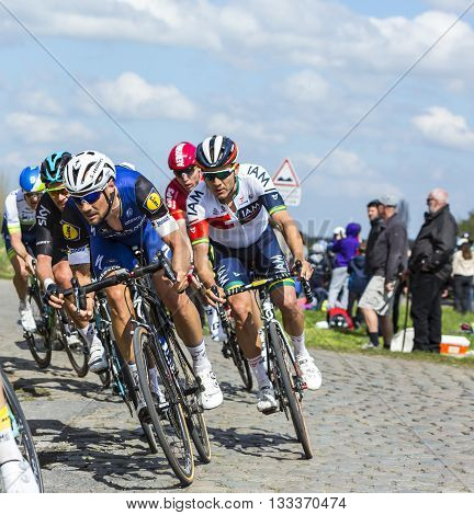 Hornaing France - April 102016: The Belgian cyclist Tom Boonen of Etixx-Quick Step Team riding in the peloton on a paved road in Hornaing France during Paris Roubaix on 10 April 2016.