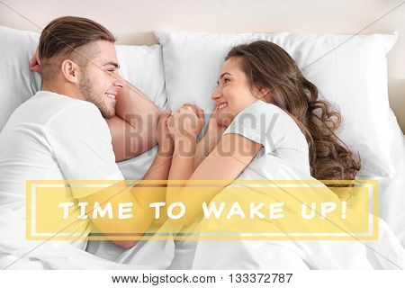 Text Time to wake up and happy couple snoozing on bed