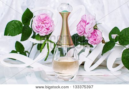 stylish bootle of perfume with pink flowers