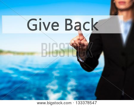 Give Back - Businesswoman Hand Pressing Button On Touch Screen Interface.