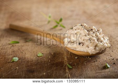 Creamy fish pate in spoon made with tuna onion and butter