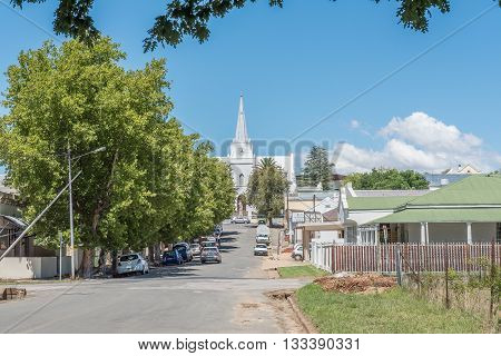 SOMERSET EAST SOUTH AFRICA - FEBRUARY 19 2016: A street scene in Somerset East with the historic Dutch Reformed Church in the back