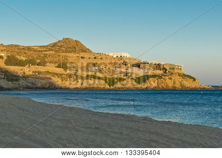 Sunset view of the Paradise beach in Mykonos island, Cyclades, Greece