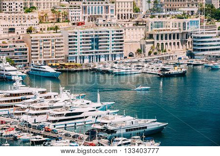 Monte Carlo, Monaco - June 28, 2015: Yachts moored at town quay In Sunny Summer Day. Monaco Monte Carlo