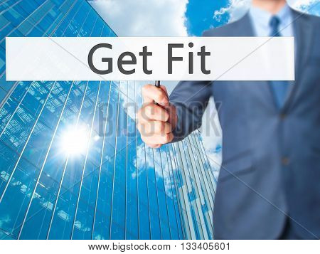 Get Fit - Businessman Hand Holding Sign