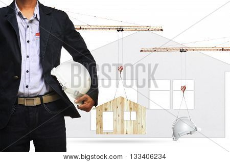 architect and construction crane lifting home and safety helmet on white background use for construction industry and residence real estate land development