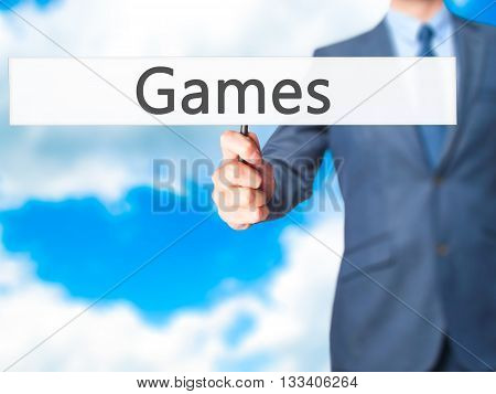 Games - Businessman Hand Holding Sign