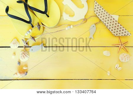 This is beach accessories on yellow wooden background