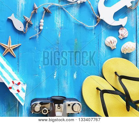 This is beach accessories on blue wooden background