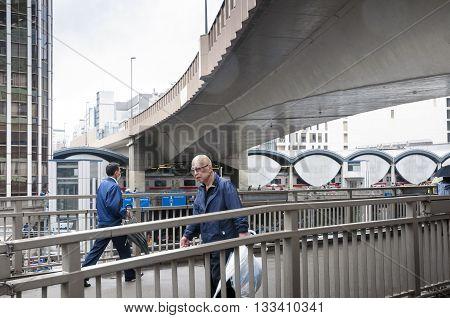 TOKYO - APRIL 23 2011: man crossing pedestrian bridge under huge hanged highway structure in Shibya district on April 23 2011 in Tokyo Japan.