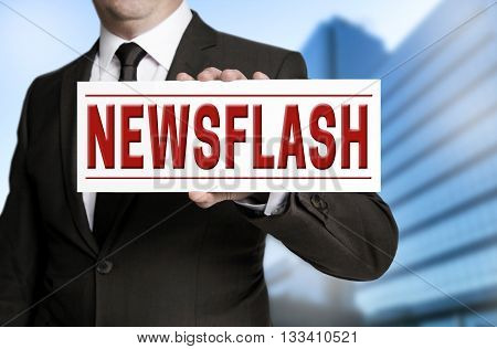 newsflash sign is held by businessman background