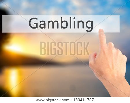 Gambling - Hand Pressing A Button On Blurred Background Concept On Visual Screen.