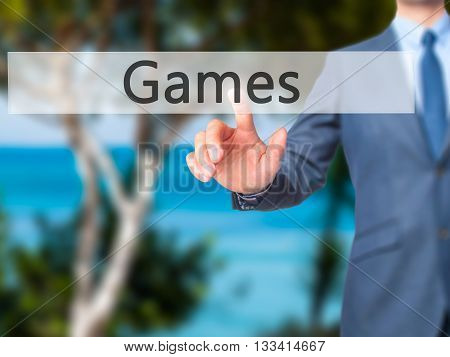 Games - Businessman Hand Pressing Button On Touch Screen Interface.