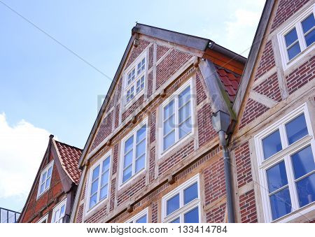 Old town houses and blue sky. Half-timbered houses of cobblestone, North Germany. Middle age or dark age building exterior.