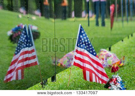 American flag reflection on a veteran memorial wall