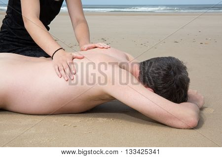 Girl Putting Sunblock On Her Boyfriend's Back