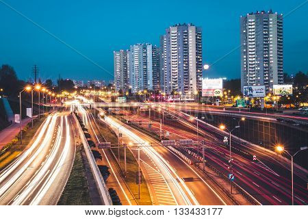 KATOWICE, POLAND - APRIL 22 2016: Trail lights created by passing cars at a busy highway in Katowice downtown.