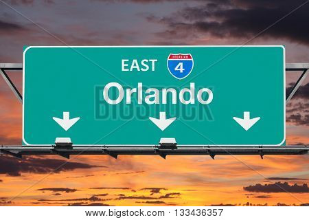 Interstate 4 east to Orlando highway sign with sunrise sky.