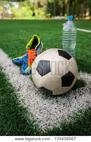 Football Cleat And Fresh Water After The Match On The Field