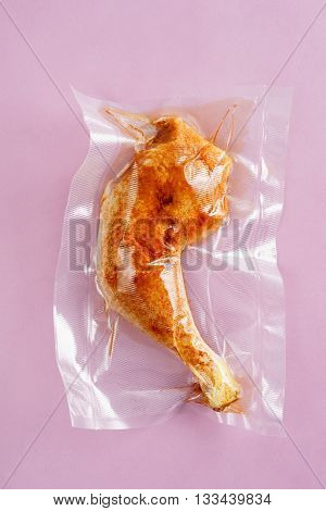 Chicken leg sealed in an airtight plastic bag ready for sous vide cooking