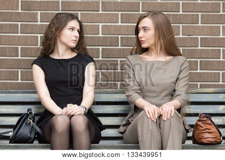 Portrait Of Two Business Rivals Women Looking At Each Other With Challenge