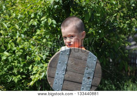 Boy Playing Role Of Young Warrior