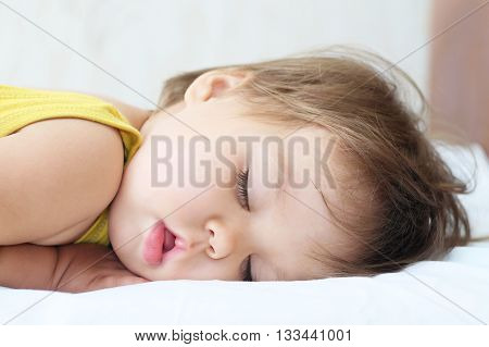 Sleeping cute Caucasian adorable baby portrait at daytime