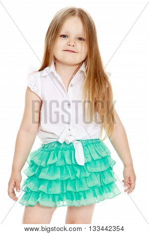 Beautiful little girl with long blond hair in a white blouse and a short skirt . close-up - Isolated on white background