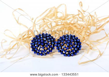 Close up of diamond earrings with diamonds