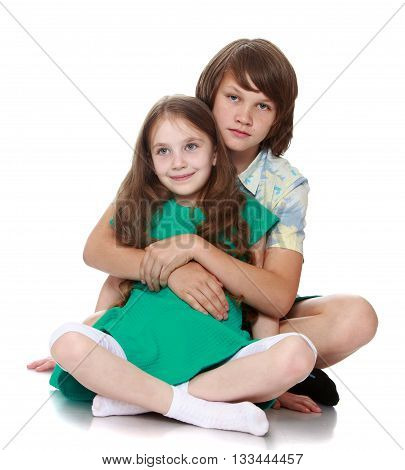 The older brother gently hugs little sister-Isolated on white background