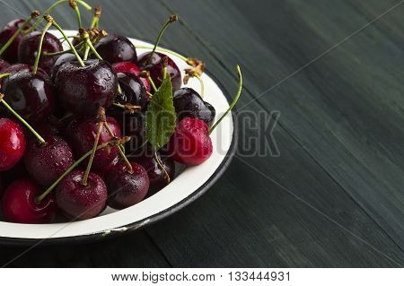 Fresh Sweet Cherry On A Dark Wooden Background