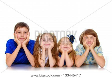 The group, two girls and two boys, all four people lying on the floor resting head on hands-Isolated on white background