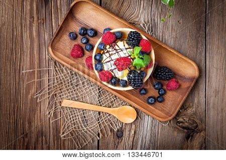 Tasty Ice Cream Dessert With Fruit In A Waffle Bowl.