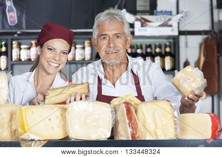 Happy Coworkers Selling Fresh Cheese In Store